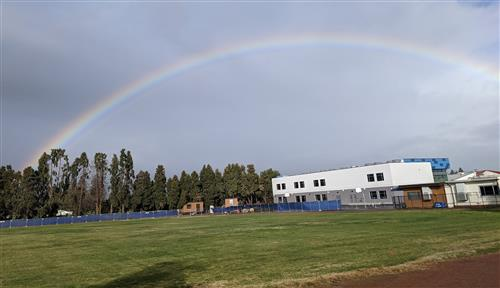 Rainbow over new building at East Avenue