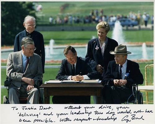 President George H.W. Bush signing the Americans with Disabilities Act.
