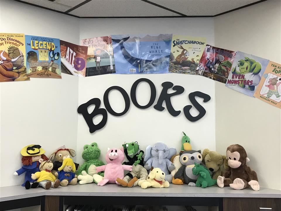 Display of book covers and stuffed animals