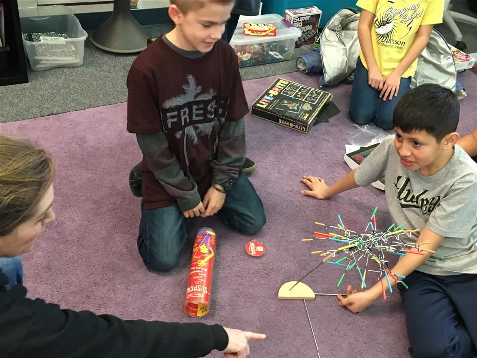 Students learning about physics playing Suspend game.